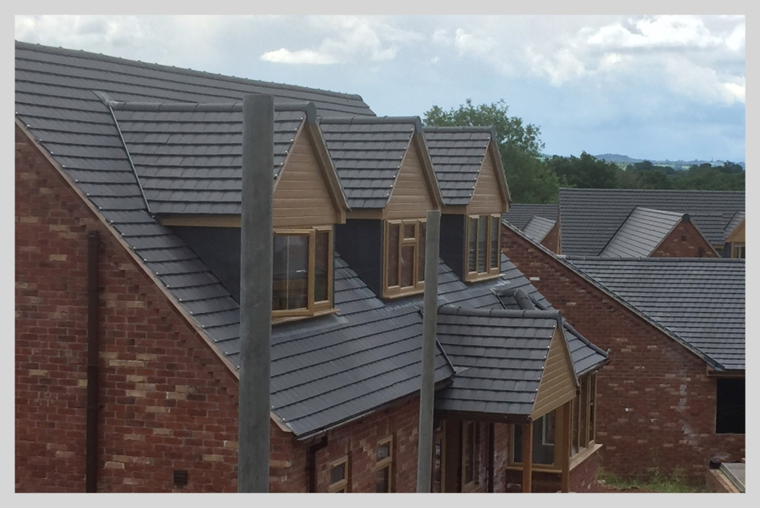 Completed new build housing estate in Shropshire, with all roofs tiled by Wyvern Roofing, Leominster, Herefordshire