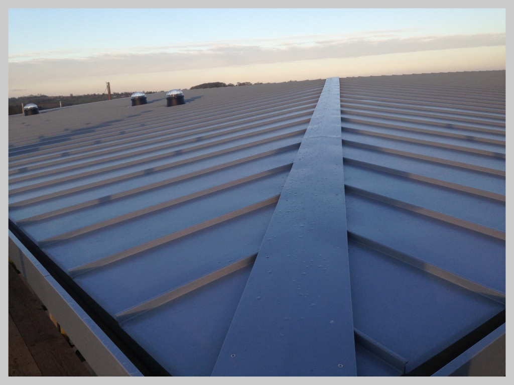 Euro Clad Single Seam industrial Flat roof by Wyvern Roofing