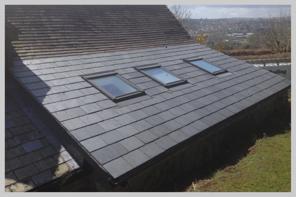 Low pitch slate roof with weather strips