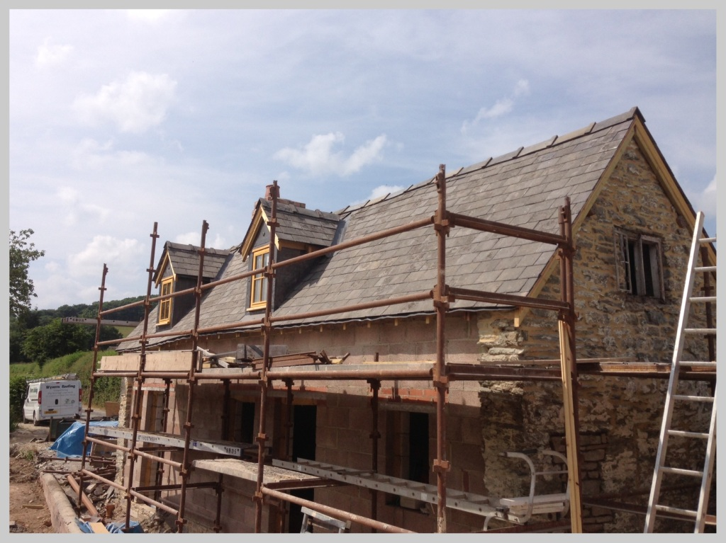 Sourced reclaimed slate roof tiles to compliment the renovation